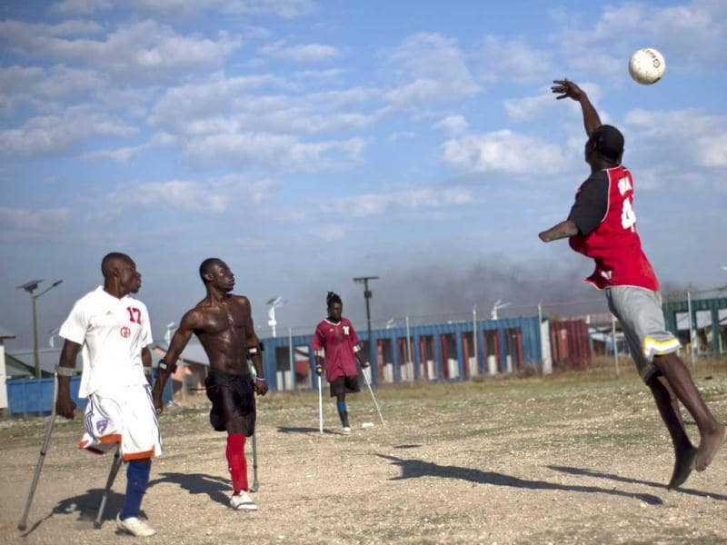 Amputees, some whose limbs were amputated due to an injuries suffered in the 2010 earthquake, play soccer at La Piste camp in Port-au-Prince, Haiti. AP Photo/Ramon Espinosa