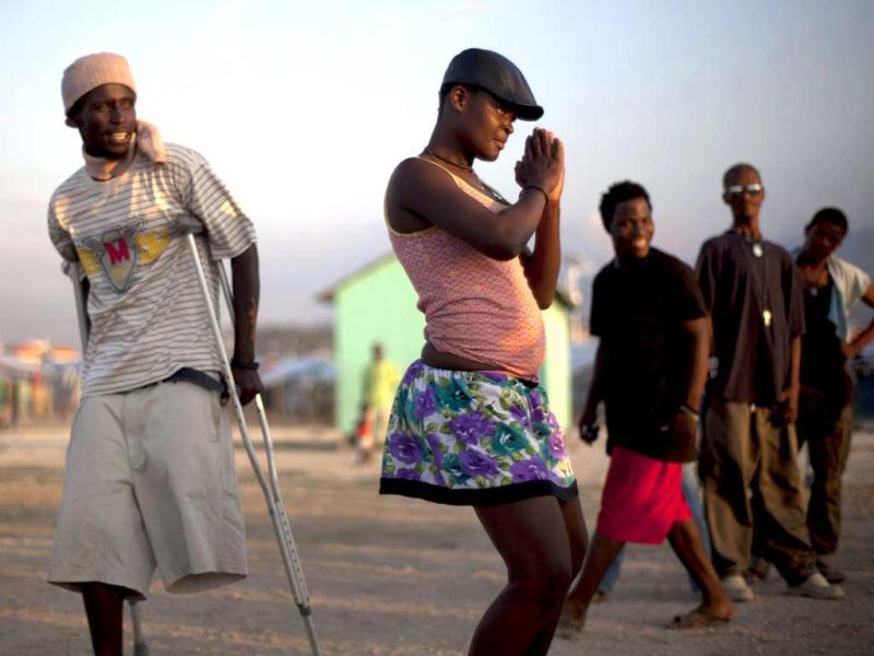A hearing impaired dancer rehearses her steps for an upcoming performance, at La Piste camp in Port-au-Prince, Haiti. AP Photo/Ramon Espinosa