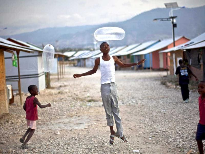 Children play with blown-up condoms at La Piste camp in Port-au-Prince, Haiti. AP Photo/Ramon Espinosa