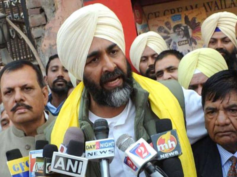 Though many consider the Congress to be the favourite, the Punjab results are too close to call. People's Party of Punjab (PPP) president Manpreet Singh Badal speaks to the press after the release of candidates list for the 2012 assembly election in this file photo. AFP/Narinder Nanu