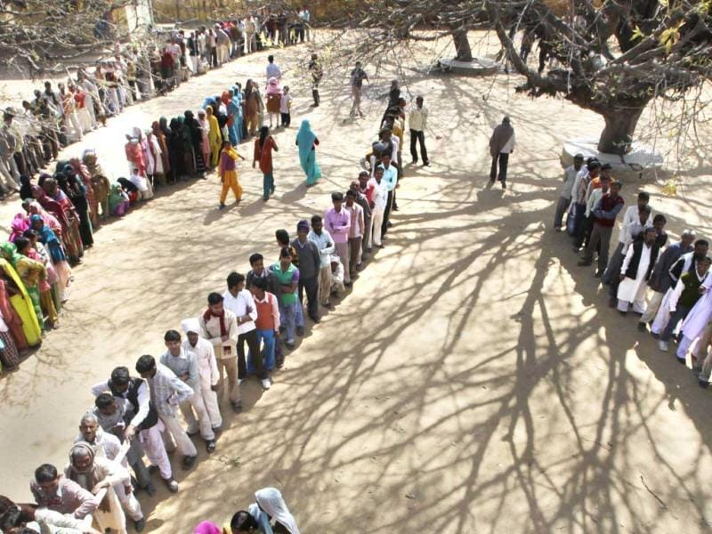 Voters stand in a queue to cast their votes at a polling station near Moradabad. By turning out in droves at the elections, the people of Uttar Pradesh have not only silenced the critics, but also made any prediction of a clear winner a risky proposition. AP/Manish Swarup.