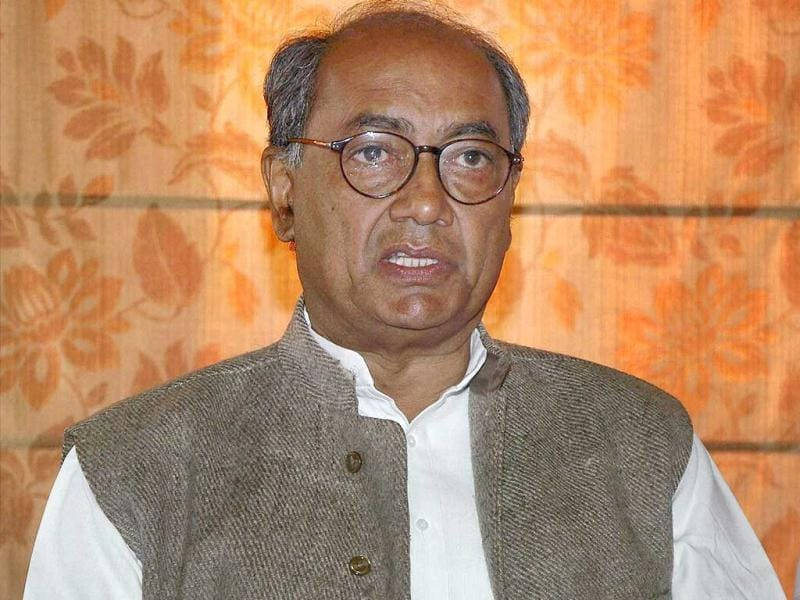Congress general secretary Digvijaya Singh said that he did not believe the exit polls' prediction that his party would win less than 40 seats in the Uttar Pradesh assembly election. Here, Singh addresses a press conference in Varanasi. PTI photo