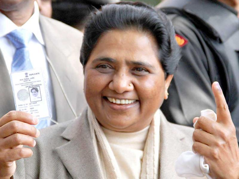UP chief minister Mayawati poses with her voter identity card and ink-marked finger after casting her vote in Lucknow. She believes that the BSP will regain power again. AFP photo