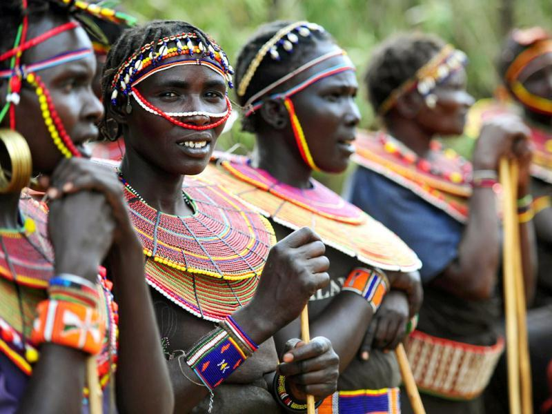 Pokot tribeswomen look on at the Gallmann nature conservancy near Kinamba, Laikipia, Northern Kenya. High Priest Shinso Ito and a group of Shinnyo-en priests arrived in Kenya to perform a Buddhist fire and water ceremony for the first time ever in Africa.The ceremony was attended by over 300 spiritual leaders and was streamed live on the internet to millions of viewers and devotees globally. The ceremony involved Kenyan tribal elders and members of the Njemps, Pokot Samburu, Kikuyu and Turkana communites. AFP PHOTO/Carl de Souza