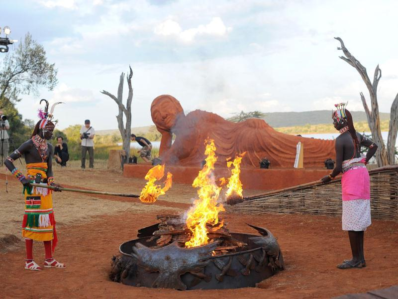 Njemps tribesmen light a ceremonial fire in front of a statue of Buddha at the Gallmann nature conservancy near Kinamba, Laikipia, Northern Kenya. Japanese Buddhist High Priest Shinso Ito and a group of Shinnyo-en priests arrived in Kenya to perform a Buddhist fire and water ceremony for the first time ever in Africa.The ceremony was attended by over 300 spiritual leaders and was streamed live on the internet to millions of viewers and devotees globally. The ceremony involved Kenyan tribal elders and members of the Njemps, Pokot Samburu, Kikuyu and Turkana communites. AFP PHOTO/Carl de Souza