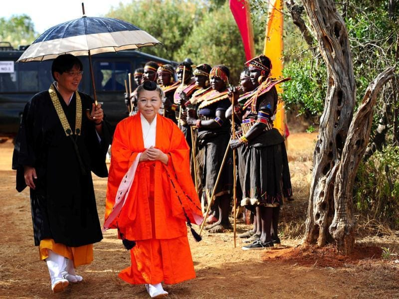 Head Priestess Shinso Ito of the Japanese esoteric Buddhist sect, the Shinnyo-en arrives at the Gallmann nature conservancy near Kinamba, Laikipia, Northern Kenya. Shinso Ito and a group of Shinnyo-en priests arrived in Kenya to perform a Buddhist fire and water ceremony for the first time ever in Africa.The ceremony was attended by over 300 spiritual leaders and was streamed live on the internet to millions of viewers and devotees globally. The ceremony involved Kenyan tribal elders and members of the Njemps, Pokot Samburu, Kikuyu and Turkana communites. AFP PHOTO/Carl de Souza