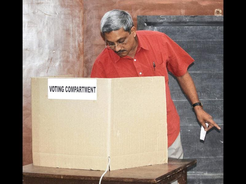 Former Goa chief minister Manohar Parrikar casting his vote at a polling station during the assembly elections in Panaji, Goa. PTI Photo