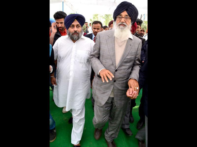 Punjab chief minister Prakash Singh Badal with deputy CM Sukhbir Badal leaving the cremation ground after the cremation of MLA Kanwarjit Singh (Suny) Brar Muktsar's village Sarai Naga. Badal faces his toughest political test as he was pitted against his own younger brother, Gurdas Badal, 81, of PPP and cousin Maheshinder Singh Badal of Congress in a bitter triangular contest for Lambi seat in southwest Punjab. Photo: Kulbir Beera/HT