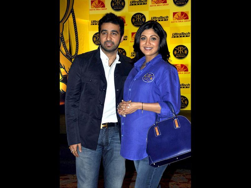 Raj Kundra with wife Shilpa Shetty pose during the event. (AFP Photo)