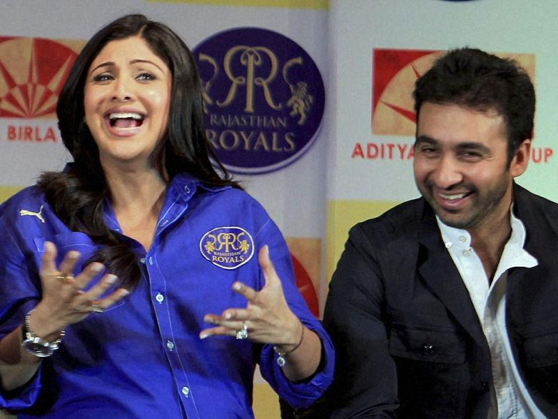 Rajasthan Royals owners Raj Kundra and Shilpa Shetty gesture at the event. (PTI Photo)