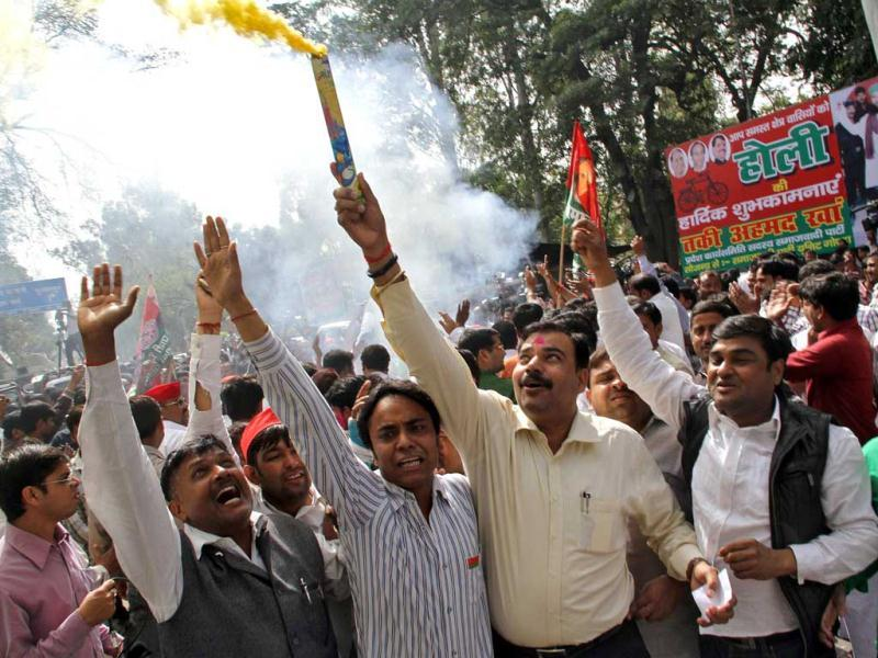 Supporters of Samajwadi Party celebrate outside their party's headquarters in Lucknow after counting of votes put it as the single largest party in UP. Reuters/Pawan Kumar