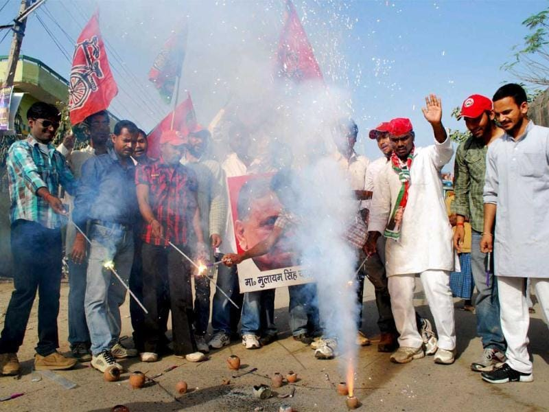 Samajwadi Party workers celebrate the success of their party in the UP assembly elections in Allahabad. PTI