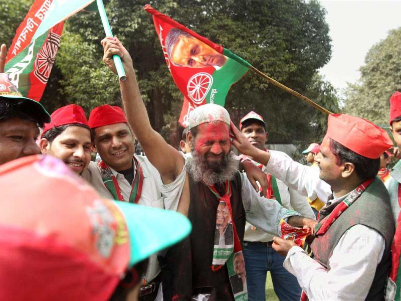 Samajwadi Party workers celebrate the success of their party in the UP assembly elections in New Delhi. PTI/Atul Yadav