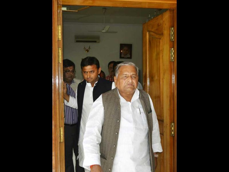 SP president, Mulayam Singh Yadav and general secretary of the party and son Akhilesh Yadav, leave their residence in Lucknow. AP
