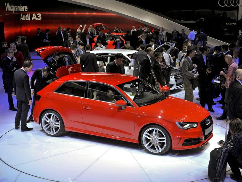 An Audi A3 is displayed as it makes its world premiere at the Italian car maker's booth during a press day ahead of the 82nd Geneva Car Show. AFP Photo/Fabrice Coffrini