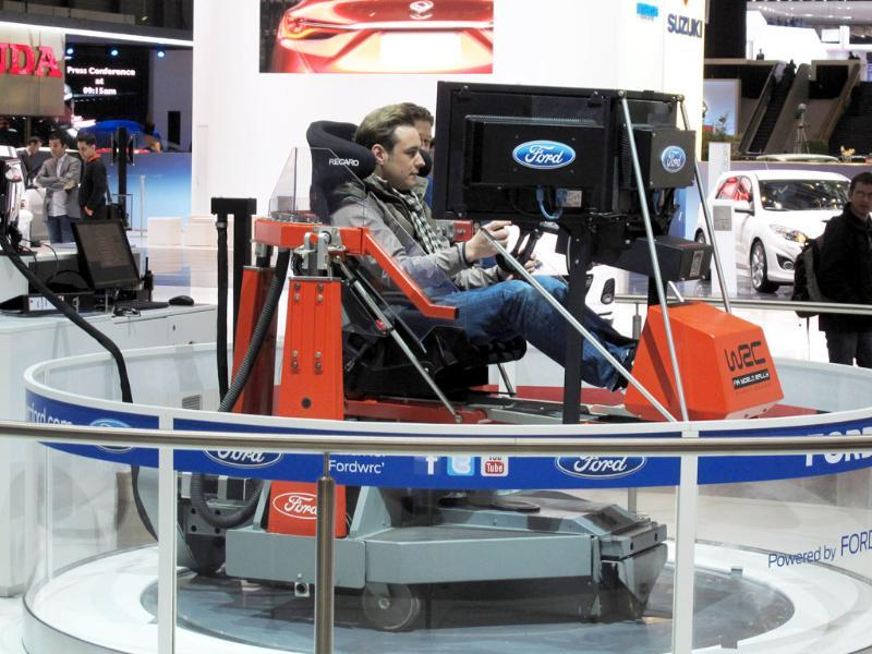 A visitor at the Geneva Motor Show tests a driving simulator. AP Photo/Frank Jordans