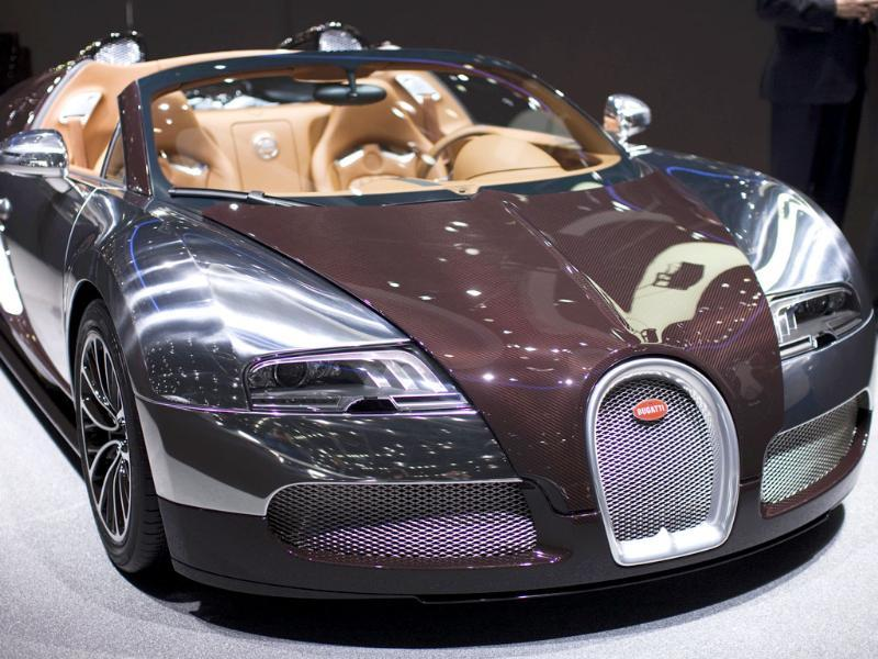 A Bugatti Veyron Grand Sport car is displayed on the car maker's booth during the first media day of the Geneva Auto Show at the . Reuters/Valentin Flauraud