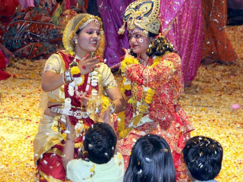 Radha Krishna dance with flowers during the Fagun Utsav at Radha Govindevji temple in Jaipur. Agencies