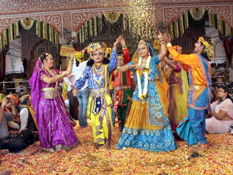 Artistes performing Radha Krishna dance with flowers to mark Holi festival during the Fagun Utsav at the historical Radha Govindevji temple in Jaipur. Agencies