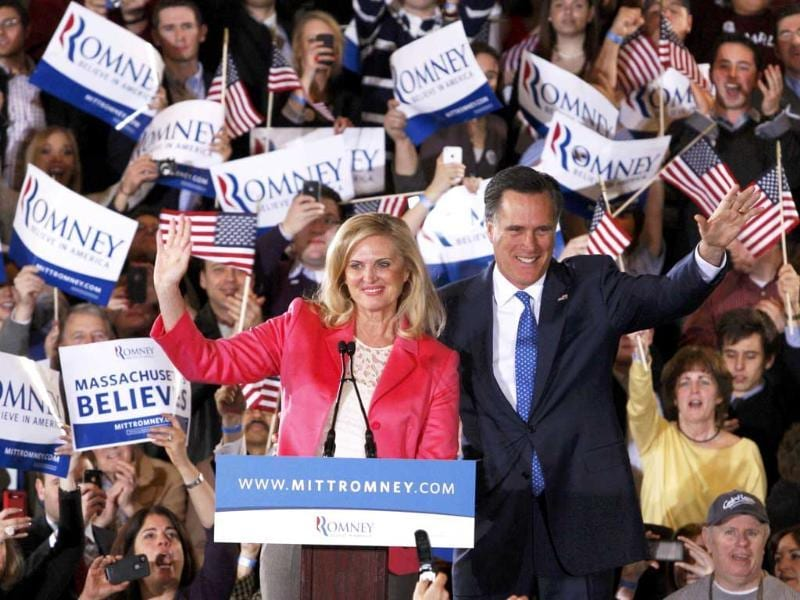 Republican US presidential candidate Mitt Romney (R) waves to supporters along with his wife Ann at his Super Tuesday primary election night rally in Boston, Massachusetts. Reuters/Jessica Rinaldi
