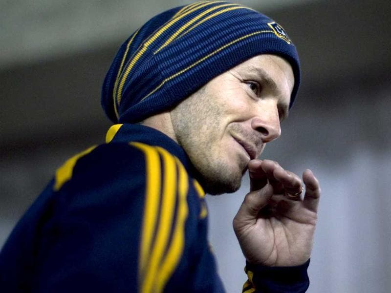 Los Angeles Galaxy's David Beckham gestures during a training session at the Rogers Centre in Toronto, ahead of their team's CONCACAF soccer match against Toronto FC. AP photo