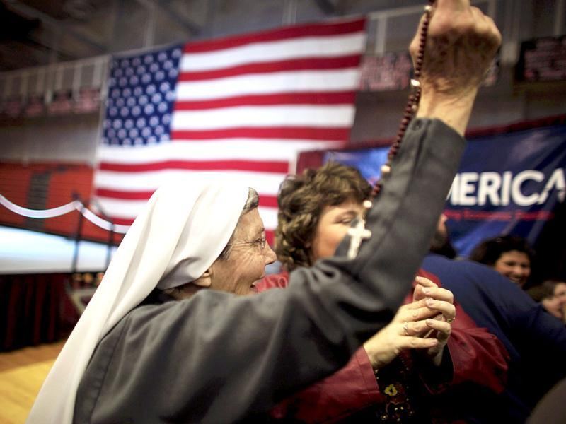 Sister Grace Anne Wills cheers with her rosary beads in her hand as she reacts to Republican US presidential candidate Rick Santorum being declared the winner in the Tennessee primary at his Super Tuesday primary election night rally in Steubenville, Ohio. Reuters/Jim Young