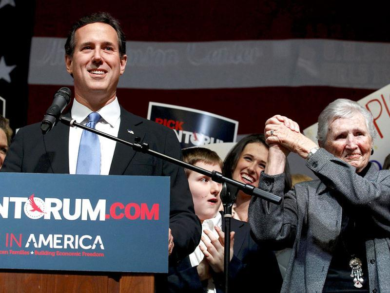 Republican US presidential candidate and former US Senator Rick Santorum is cheered by his 93 year old mother Catherine as he speaks to supporters at his