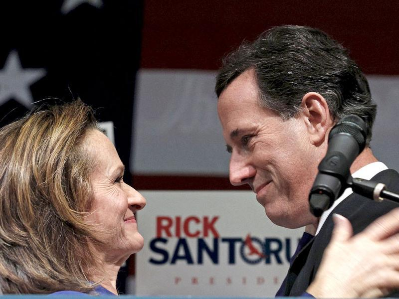 Republican US presidential candidate Rick Santorum (R) smiles at his wife, Karen on stage at his