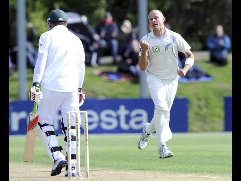 New Zealand's Chris Martin, right, celebrates the wicket of South Africa's Jacques Kallis caught by Ross Taylor for 0 on the first day of the first International Cricket Test in Dunedin. AP/Ross Setford