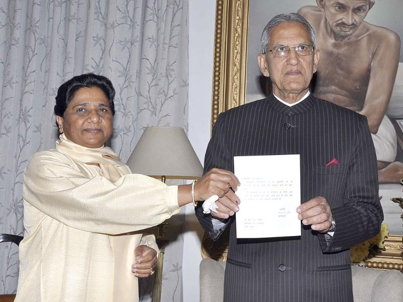 Uttar Pradesh chief minister Mayawati handing over her resignation to governor BL Joshi in Lucknow.