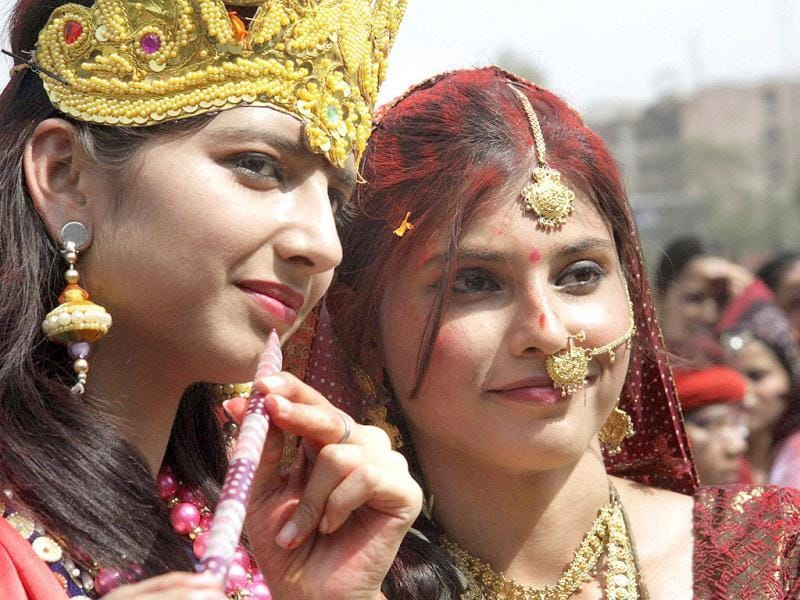 Students pose as Lord Krishna and Radha as they celebrate Holi at their college in Patna. PTI Photo