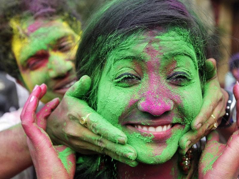 A student of Rabindra Bharati University applies coloured powder to a fellow student's face as they celebrate Holi, also known as the festival of colours in Kolkata. Reuters/Rupak De Chowdhuri