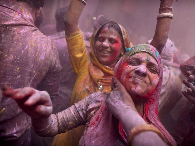 Devotees smear color on each other while celebrating Holi at the Banke Bihari temple in Vrindavan. AP Photo/Kevin Frayer