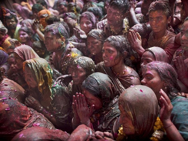 Devotees crowd as they look at a deity of Lord Krishna while celebrating Holi, the festival of color, at the Banke Bihari temple in Vrindavan. AP Photo/Kevin Frayer