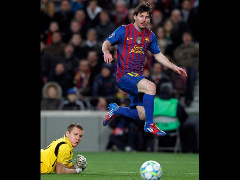 Barcelona's Lionel Messi scores his fourth goal past Bayer Leverkusen's goalkeeper Bernd Leno during their Champions League last 16 second leg soccer match at Nou Camp stadium in Barcelona. Reuters/Albert Gea