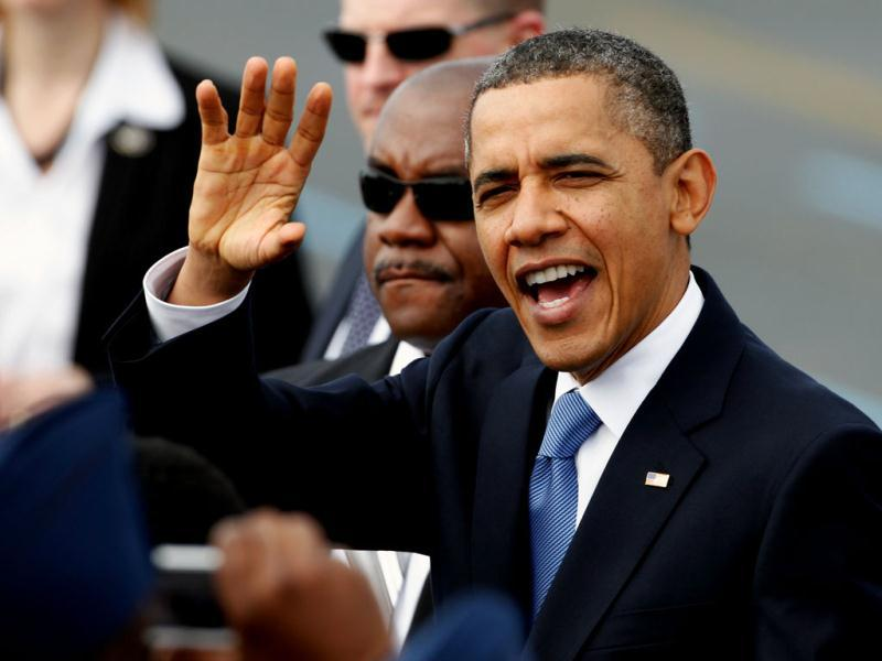 President Barack Obama waves to the crowd gathered on the tarmac at the North Carolina Air National Guard Base in Charlotte. AP/Bob Leverone