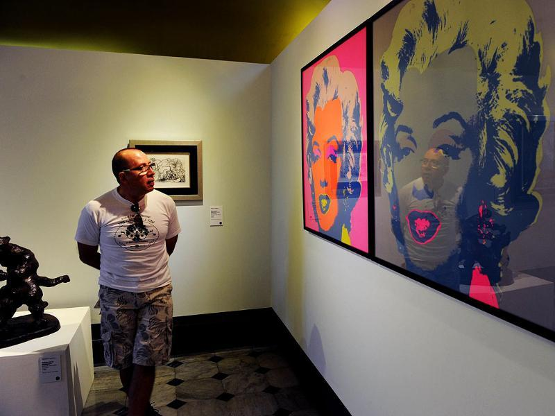 A visitor stands beside Andy Warhol's