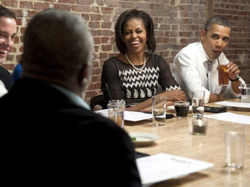US President Barack Obama and First Lady Michelle Obama have dinner with winners of a Democratic campaign contest at the Boundary Road restaurant in Washington, DC. Three winners and their guests each won the