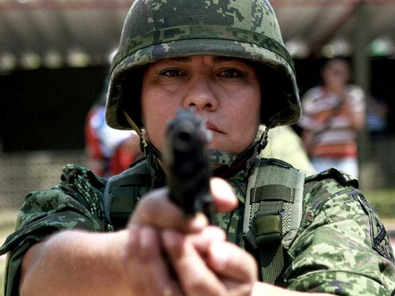 A female member of the Mexican Army takes part in a military drill at the Six Military Region in Boca del Rio, Veracruz. Some twelve thousand women in the states of Veracruz and Puebla are currently in the Army with some of them participating in the military operation called