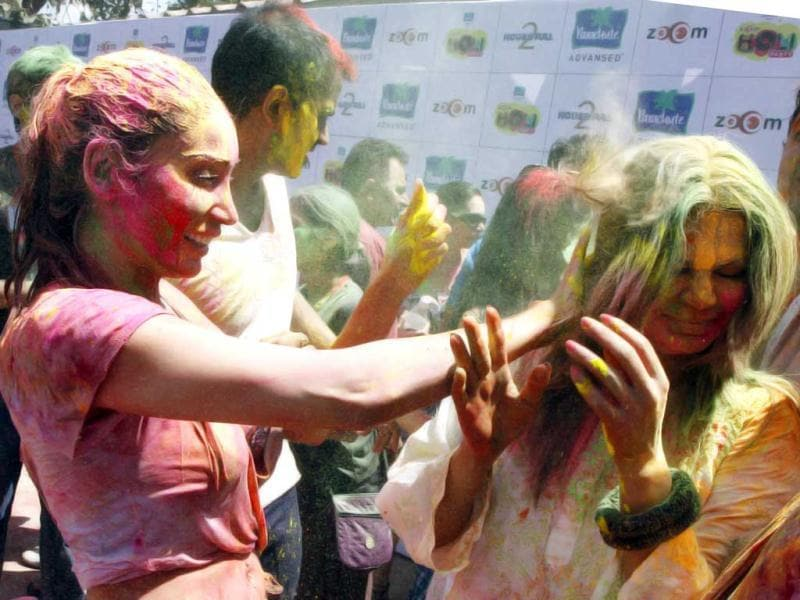British Asian actor Sofia Hayat and Rakhi Sawant celebrate Holi at a Zoom party in Mumbai on March 8. (AFP Photo)