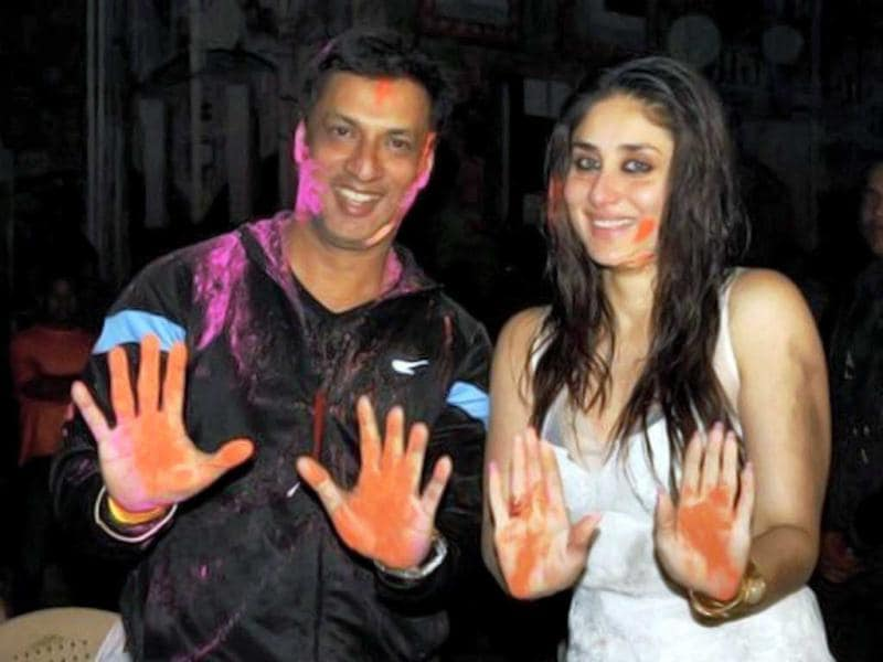 Director Madhur Bhandarkar and actor Kareena Kapoor celebrate Holi on the sets of Heroine in Mumbai on March 8. (PTI Photo)