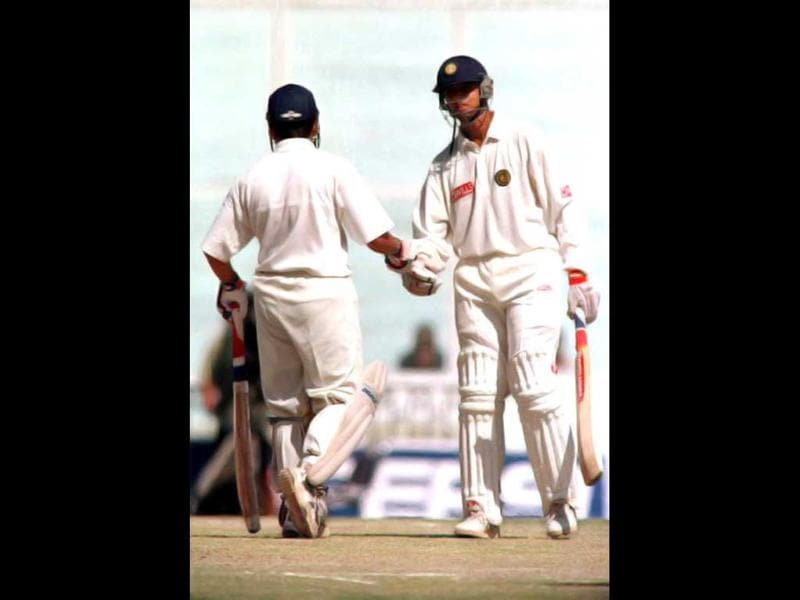 Sachin Tendulkar congratulates Rahul Dravid after he made a century on the fourth day of the first test match against New Zealand in Mohali 13 October 1999. India declared its 2nd innings at 505. Rahul Dravid scored 144 and Sachin scored 126* . AFP Phot