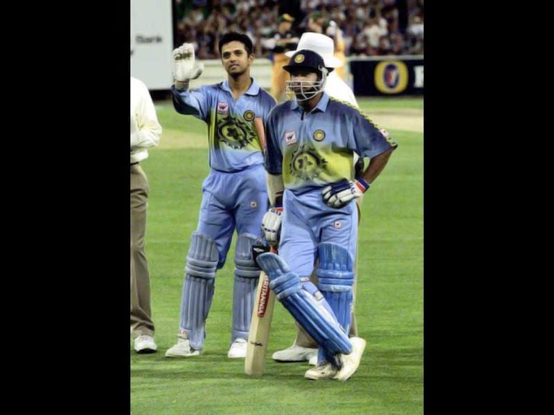 Rahul Dravid (L) and Robin Singh plead with their fans after Indian fans pelted the ground with plastic bottles delaying play because they were unhappy with the decision which saw Saurav Ganguly run-out at the MCG in Melbourne on 12 January 2000. AFP Photo/Andrew Tauber