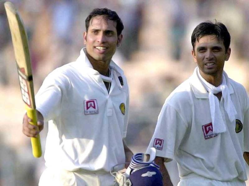 VVS Laxman (L) points his bat towards the cheering crowd as team-mate Rahul Dravid looks on as they walk back to the pavillion on the fourth day of the second test match between India and Australia at Eden Gardens in Calcutta 14 March 2001. Dravid and Laxman scored unbeaten 154 and 275 runs repectively to help India move to a strong position at 589 for 4 in its second innings at end of day's play. AFP Photo/Arko Datta