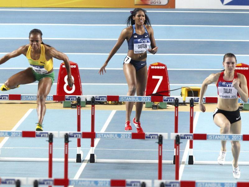 United States' Kristi Castlin reacts after the start of a Women's 60m hurdles first round heat during the World Indoor Athletics Championships in Istanbul. (AP Photo/Michael Probst)