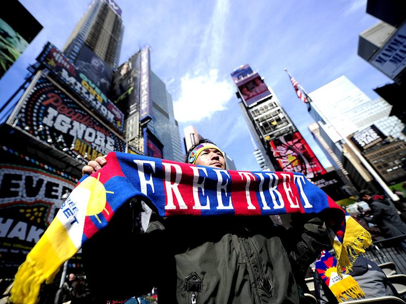 Tibetan activists stage a demonstration on Times Square to call for the release of imprisoned Tibetan filmmaker Dhondup Wangchen on the eve of the 1959 Tibetan uprising, in New York. AFP Photo/Emmanuel Dunand