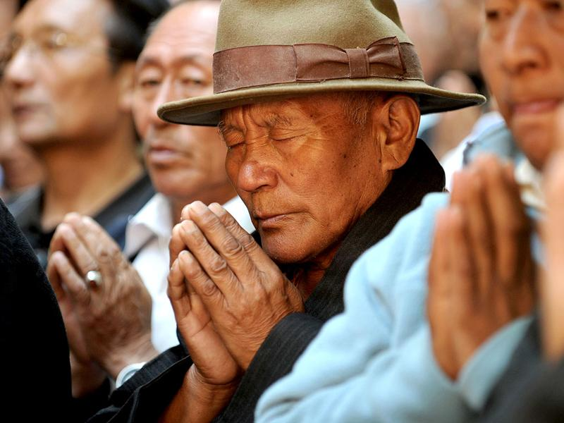 Tibetans in exile pray at a ritual marking the 53rd anniversary of the 1959 Tibetan uprising against Chinese rule, at Boudhanath in Kathmandu. AFP/Prakash Mathema