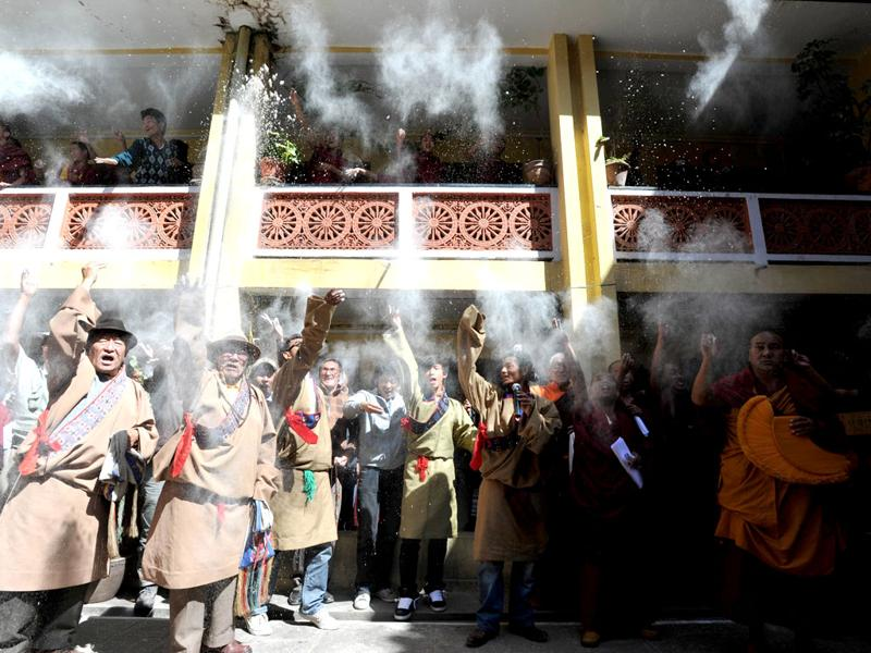 Tibetans in exile throw flour in the air at the Boudhanath Stupa during the 53rd anniversary of the 1959 Tibetan uprising against Chinese rule, at Boudhanath in Kathmandu. AFP/Prakash Mathema