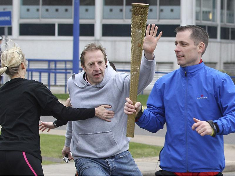 Police officers designated to protect the Olympic torch, the Olympic Torch Security Team, demonstrate to the media how they will protect the torch bearers and Olympic flame during the torch relay's progress through Britain, at the Metropolitan Police training school in Hendon, north London.(Reuters)