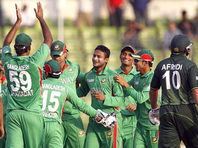 Bangladesh's Shakib Al Hasan, center without cap, celebrates with teammates the dismissal of Pakistan's Shahid Afridi, right, during their Asia Cup cricket match in Dhaka, Bangladesh. AP/Aijaz Rahi